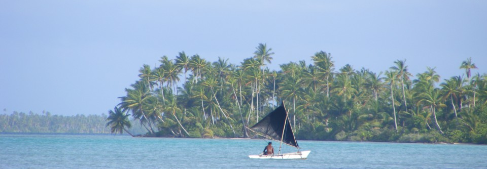 Kiribati canoe and fisherman