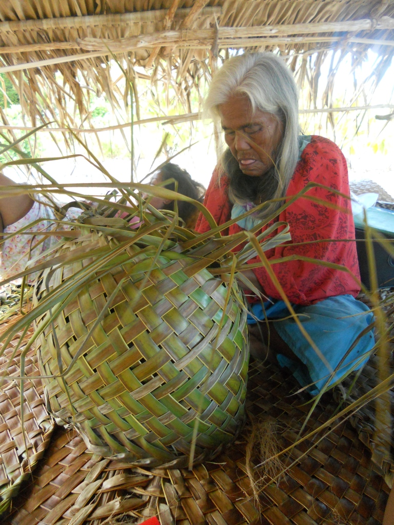 Terira (grandma) weaves a basket